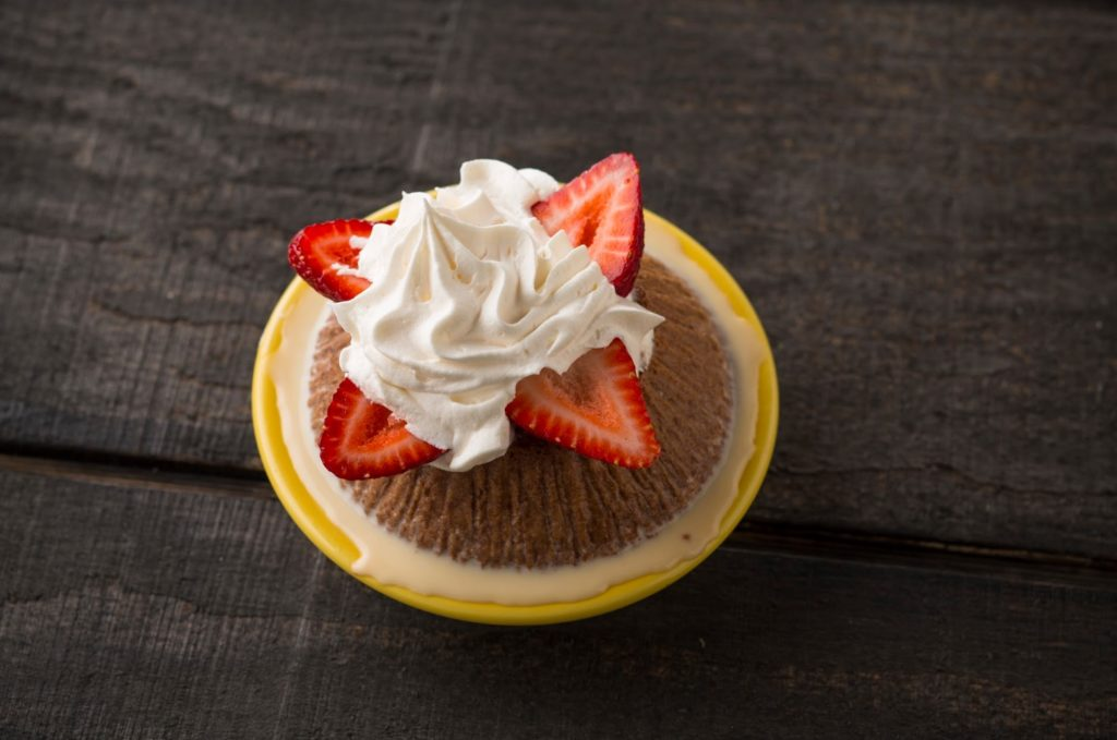 A Costa Vida tres leches dessert, covered in strawberries and whipped cream.